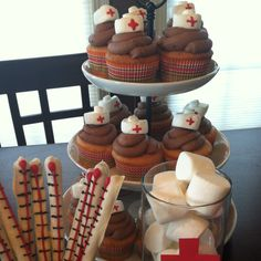 Nursing Graduation party: nursing cap cupcakes, choc-dipped pretzel thermometers, & cotton ball marshmallows