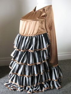 bustle that could use a matching bustle pad worn under the bustle over the bum so help support the weight of the cage and petticoat ruffling.