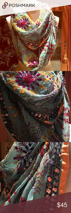 """Infinity 100% silk scarf from India in Turquoise Infinity scarf from India, handmade and feels like a gauze. Lots of beading, sequins, embroidery designs and trimmed in peach. Approx 40"""" long doubled and width is approx 18"""". Light weight and super fun! Raj Accessories Scarves & Wraps"""