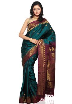 Teal Blue pure gadwal handloom silk zari woven saree. As shown in the below thumbnail image dark magenta pure gadwal handloom silk blouse fabric is available.