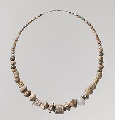 Beads from a Necklace Date: 6th century Culture: Frankish Medium: Glass, copper alloy rings                                                                                 Date:                                 ...