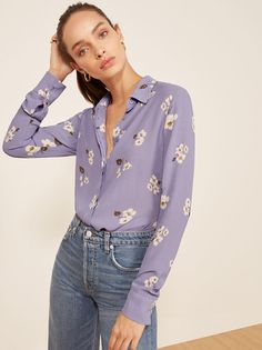 Get on tops. This is a long sleeve, button front shirt with a collar.