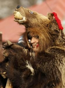 A man dressed in a bear costume takes part in a traditional fair for Christmas and New Year celebrations at the Village Museum in Bucharest,. Traditional Christmas Food, Bear Mask, Men Dress Up, Bear Costume, Les Religions, Historical Artifacts, New Year Celebration, Green Man, Brown Bear