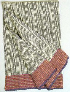 "handwoven herringbone towel, dark gray warp with hot pink and bright yellow stripes at ends, 17"" x 27"""