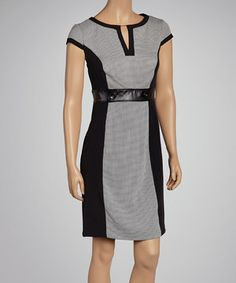 With its classic tweed fabric and tailored silhouette, this dress will make a sophisticated choice for those desk-to-dinner days. Color blocked panels and faux leather detailing contour the figure for a fashionably flattering look