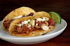 Smoky Pork Tinga Tacos with Avocado and Fresh Cheese