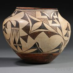 Acoma Polychrome Pottery Jar, c. first quarter 20th century, decorated with a curvilinear design including hachuring, abstract feather, and foliate devices, ht. 9 1/4, dia. 10 1/2 in.