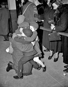 History in Photos: Alexandra Studio. Soldier embracing two children, 1940s