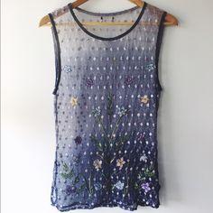 Vintage embroidered Mesh Tank Top S Super adorable embroidered mesh tank top. Completely see-through, perfect with a tank or bralette underneath! Also awesome for festivals! Vintage, but in great condition. Missing the tag, so not sure the brand. Size small. Tops Tank Tops