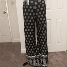 "HP Black & White Graphic Print Palazzo Pants HP-Essential Style Party Black & White Graphic Printed Palazzo Pants with Wide Leg and Fold Down Waist. Waist measures 5 1/2 inches (unfolded). Inseam 10 1/2 inches and Length is 41 inches from the waistband. Inseam is 32"". NWOT. Made from stretchy polyester blend. PRICE FIRM Moa Moa Pants Wide Leg"