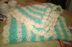 Manta de bebé tejida en crochet