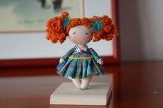 A cute miniature cloth doll with beautiful blue eyes . She has lovely curly redhead hair. 100% handmade this tiny collectible doll is perfect way to say I love you mom. A classic for a dollhouse 1:12 or a collection or a decoration for the house associated with a glass bell presenting our shop or a night light This cute little sweety can't wait to find a lovely home. If you want to personalize your doll (hair color, accessories etc ...), write to me ! I am always at your disposal :)