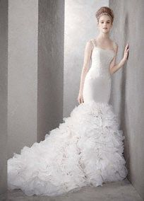 White by Vera Wang for David's Bridal Kim Kardashian Replica Georgette Mermaid Gown with Dramatic Organza Skirt   Georgette mermaid gown with draped straps and Chantilly lace appliques at bodice.