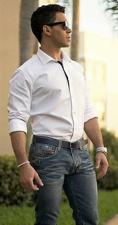 Looking good in designer jeans with fine normal bulge.