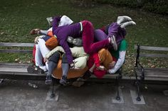 "Performers form a ""human sculpture"" during a piece entitled ""Bodies in Urban Spaces"" by choreographer Willi Dorner."
