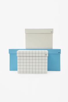 A set of three in assorted sizes, these cardboard boxes are designed to organise…