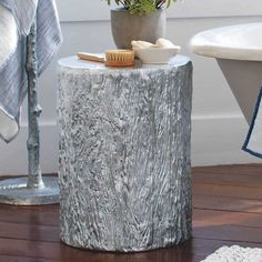 Recycled Aluminum Tree Trunk - VivaTerra (and the metal branch coat/towel tree next to it!)