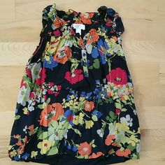 NEW LISTING | LOFT floral shell Adorable and fun print. Gauzy cotton & silk blend. Lined. Navy blue background. Ruffle at the collar. Excellent condition. LOFT Tops Blouses