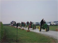 I heart this idea - Have wedding party arrive on John Deere tractors.