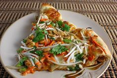 Thai Chicken Pizza With Spicy Peanut Sauce. So good. I love strange pizza toppings.