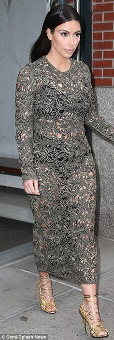 Kim Kardashian showed off her black bra and high-waisted underpants in a lace grey dress