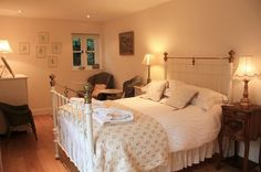 Antique brass bed at Blakeney Cottage. This whole guestroom looks so welcoming and cosy