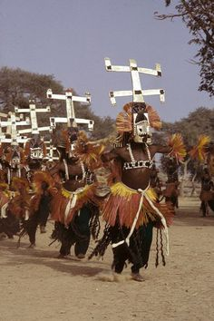 Africa | Kanaga masked dance during a Dama (funeral).  Dogon Country, Mali |  ©Michel Renaudeau