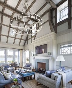 Where do we even start with this gorgeous East Quogue living room? The ceiling beams, that chandy 😱, the lovely blue and white palette 💙, or the wonderful pattern play (look at the fireplace!) Genius design by @ramsarchitects. What's your favorite part? #kathykuohome #interiordesign #livingroom #inspiration