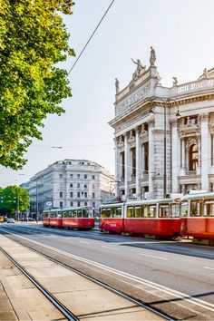 Famous Wiener Ringstrasse with historic Burgtheater (Imperial Court Theatre) and traditional red electric tram at sunrise with retro vintage in Vienna Austria Mykonos, Empire State, Global Holidays, Rivers And Roads, Travel Music, Beautiful Places In The World, Travel Activities, Places To Visit, Around The Worlds