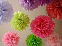 Hanging Pom-Poms    1. Stack eight 20-by-30-inch sheets of tissue. Make 1 1/2-inchwide accordion folds, creasing with each fold.    2. Fold an 18-inch piece of floral wire in half, and slip over center of folded tissue; twist. With scissors, trim ends of tissue into rounded or pointy shapes.    3. Separate layers, pulling away from center one at a time.  4. Tie a length of monofilament to floral wire for hanging.