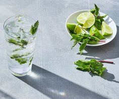 Mojito | The bracing combination of citrus and mint is an excellent foil for sweet rum in this classic Cuban cocktail. White rum is preferred over darker types for its clarity of color. Served over ice and topped off with soda water, mojitos are ideal thirst-quenchers for summer parties.  #drinks #cocktails #recipe #marthastewart