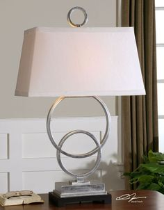 Savor the exquisite lines and elegance of our Boutique Silver Entwined Circles Table Lamp.