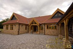 Single storey country residence in Essex - Oakmasters - Front exterior of single storey country residence with oak frame windows and porch