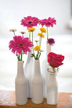 #DIY tip: Spray paint empty bottles lying around in your house to get pretty flasks to hold flowers!