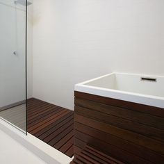 shower with ipe floor, ipe wrapped soaking tub