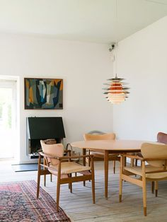 Finn Juhl's House - Cereal Funky, gorgeous statement lighting in a space that balances minimalism and homeyness.