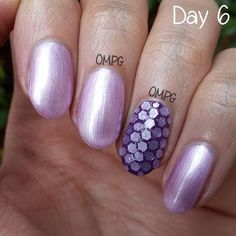 Day 6, violet theme, a.k.a. the 'Air Bubbles theme'. If you don't know what I'm taking about, stare at the photo till you can see the air bubbles on the accent nail (that's the ring fingernail, in case you don't know) That happened because the hexes aren't pieces of loose glitter, but part of a glitter polish, that's why so many bubbles