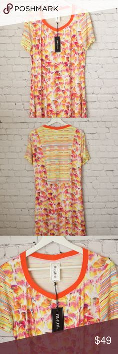 """Eva & Claudi Butterfly Knit Dress Size L NWOT Brand: Eva & Claudi  Size: L  Approx. Measurements: flat, relaxed Length = 40"""" Chest at armhole = 19 1/2"""" Sleeve length = 8 1/2"""" Sleeve opening = 6 1/4"""" Sweep, bottom opening = 27 1/4""""  Details: New. This super cute brightly colored Rayon dress has original product tag with style and UPC info, but not the price tag.     Short sleeve knit dress.  Front has center panel with butterfly print.   Back has panel on top back in stripe pattern.   Sleeves…"""