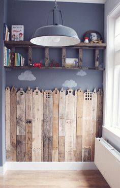 Pallets as a skyline for a kiddo's playroom. What a great way to recycle old boards!