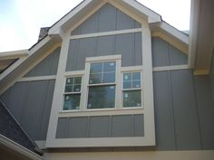 View of the window with James Hardie Gray Slate Board and Batten Siding Hardie Plank Colors, Siding Colors, Exterior Colors, Exterior Paint, Hardie Board Siding, Wood Siding, Ranch House Remodel, Deck Fireplace, Building Exterior