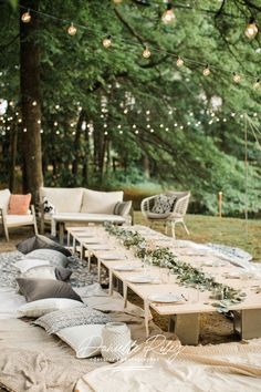 Backyard picnic with fairy lights, rustic picnic tables, pretty table decorations and plenty of comfy cushions tables lights Picnic under the trees ~ Rustic boho wedding reception Outdoor Wedding Reception, Diy Wedding, Wedding Venues, Wedding Ideas, Wedding Backyard, Wedding Ceremony, Nikah Ceremony, Small Wedding Receptions, Backyard Wedding Decorations