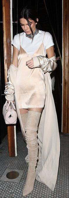 Who made Kendall Jenner's silver jewelry, tan thigh high boots, satin nude trench coat, and beige handbag?