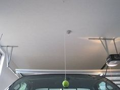 25+ Easy and Useful Car Hacks Every Driver Should Know --> Hang a Tennis Ball as a Parking Guidetrick to Avoid Bumping the Garage Wall and Scraping the Vehicle Bumper #car #hack #tips
