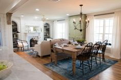 The dining room was more of a transitional space from the entry to the living space, but it was close to the kitchen and became the perfect area to hang a chandelier and create a not-so-formal dining room.