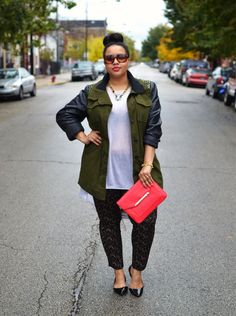 Gabi Fresh looking so fly with the Tia Crossbody turned Clutch in cerise. #streetstyle #stelladotstyle