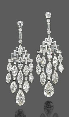 A PAIR OF ART DECO DIAMOND EAR PENDANTS, BY BULGARI. Each designed as a geometrical baguette and brilliant-cut diamond top suspending a flexible cascade of marquise-shaped diamonds with a pear-shaped diamond terminal, mounted in platinum, 1920s. #Bulgari #ArtDeco #earrings
