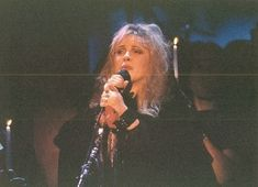 Stevie onstage ~ ☆♥❤♥☆ ~ overcome by the lyrics of the song she was singing that night