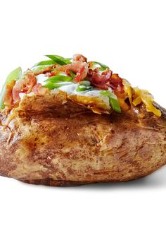 NYT Cooking: Recipes for baked potatoes exist across the archives of The Times. This is the battle-tested best. Adorn the result with toppings: sour cream, minced chives, crumbled bacon, chopped jalapeño, cauliflower florets, crab meat dressed in lemon juice. The potatoes are a blank canvas, though delicious on their own.