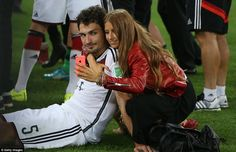 Time for a selfie: Fischer captures the moment on the pitch with Hummels...