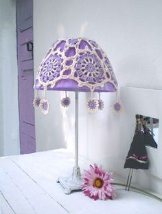 This crochet lampshade is by Daniela Cerri as featured in an interview on the Angiolina & Audrey blog
